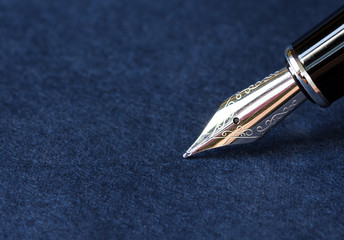 Fountain pen on blue background with clipping path.