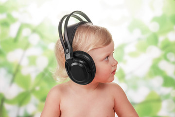 Little baby with headphones