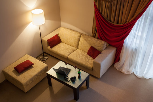 interior with sofa and coffee table with laptop and camera