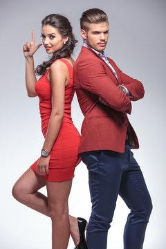 man and woman secret agents posing