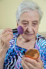 senior woman making make up