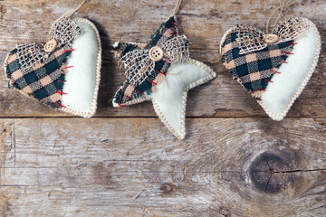 fabric country hearts and star hanging on wooden
