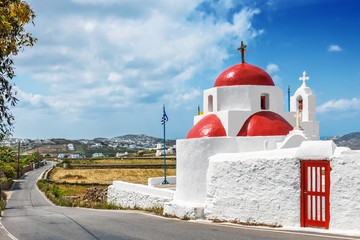 White chapel with red dome in Tourlos, Mykonos