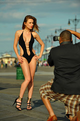Photographer taking picture of beautiful young swimsuit model