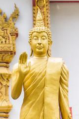 Standing Thai Golden Buddha statue
