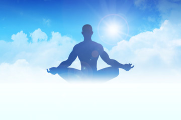 Silhouette of a man figure meditating on clouds