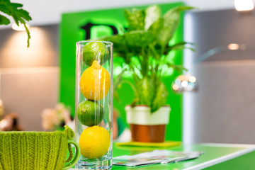 Lemons and other home decorations in glass bowl