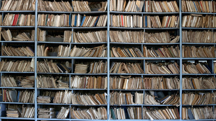 shelves full of files in a messy old-fashioned archive Wall mural