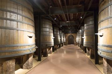 wooden barrels in old cellar
