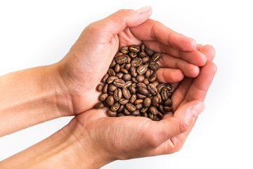 Young woman's hands holding coffee beans