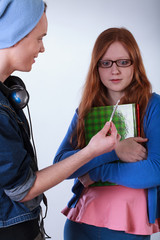 Naughty boy giving girl a marijuana joint
