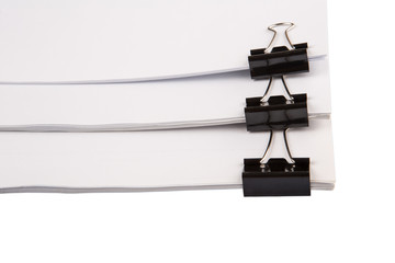 Binder clips with black white paper over white background