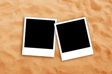 Two Blank photo frames on beach sand