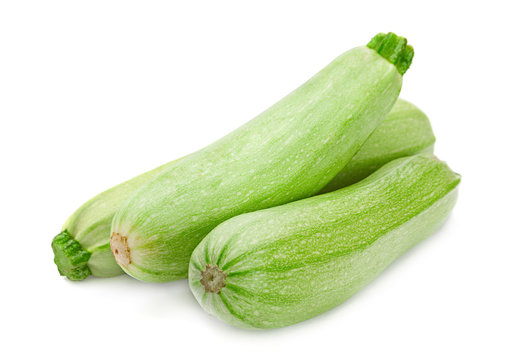 Zucchini vegetable closeup isolated on white