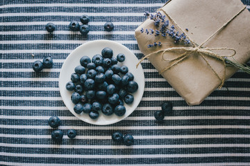 Plate with blueberries on a striped tablecloth