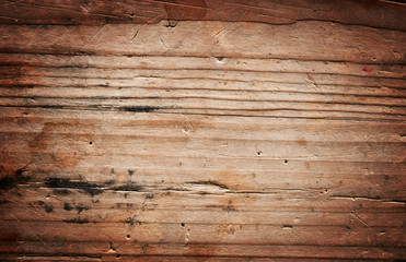 Old brown grungy wooden plank
