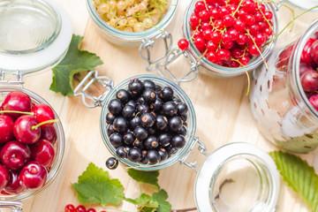 black red white currants gooseberries cherries jars preparations