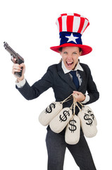 Businesswoman with sacks of money and gun isolated on white