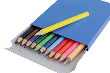Many colored pencils in carton box