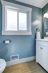 Bright bathroom in light blue