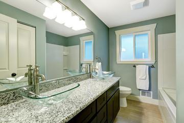 Modern bathroom interior in soft aqua color