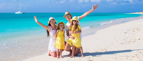 Happy family with two kids on caribbean vacation
