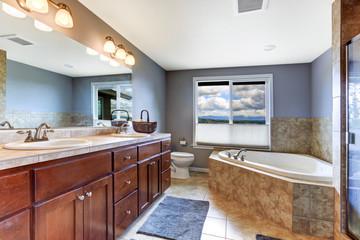 Lavender bathroom with mocha tile bath trim
