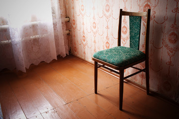 the old chair rubbed from time costs in the room