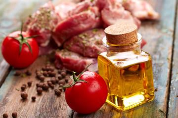 Raw steak and oil bottle
