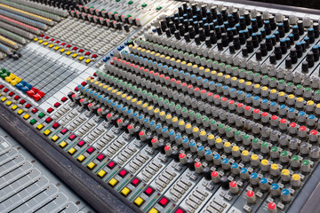Closeup of buttons of a studio mixer