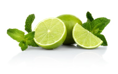 Three sliced limes with mint isolated on a white background