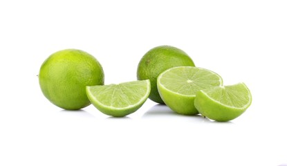 Three sliced limes isolated on a white background