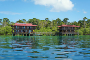 Tropical hotel on stilts over water Caribbean sea