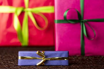 Three presents, bows and ribbons.