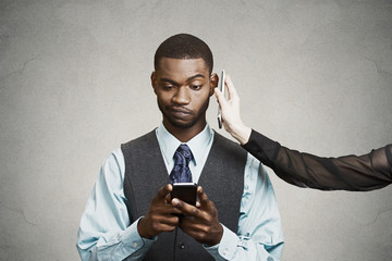 Headshot confused businessman reading bad news on smart phone