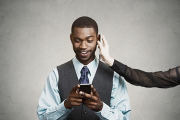 Happy businessman reading news on smart phone