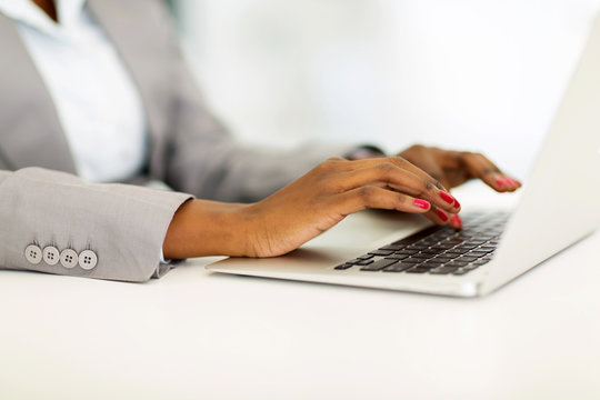 african businesswoman hands working on laptop
