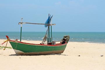 Fishing boat the sand sea beach.