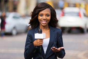 african female news reporter in live broadcasting