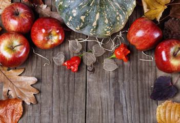Autumn (fall) still life with pumpkin, apples and leaves