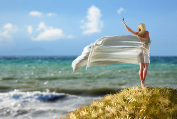 woman with a tissue on a beach