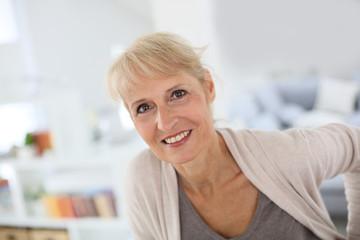 Portrait of smiling blond senior woman