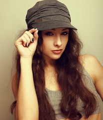 Sexy female model in cap looking sexy. Vintage portrait