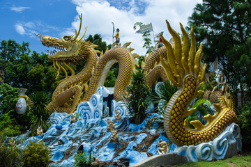 Colorful dragon statue with blue sky at public park, Thailand.