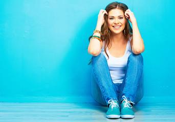 Hipster girl sitting on floor Wall mural