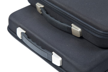 Black briefcase overlapping.