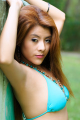 Young redhead Asian features in bra
