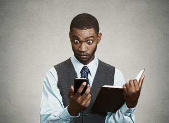 Surprised executive reading breaking news on smart phone