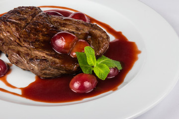 grilled beef steak with plums
