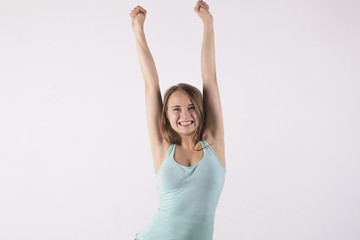 happy woman with her hands up